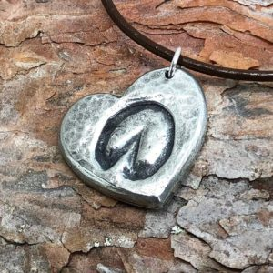 """Walk On!"" donkey hoof print necklace"